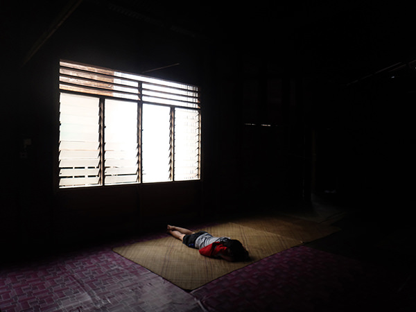 Quiet Times #6 by Jeremy Chin - Sleeping in Long House, Bario, Sarawak