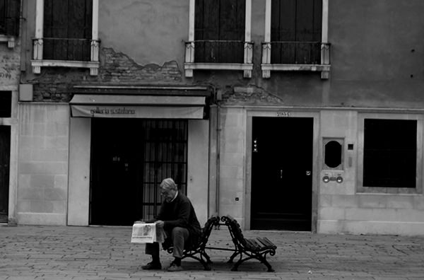 Quiet Times #7 by Jeremy Chin - Reading Newspaper on the Bench, Venice, Italy