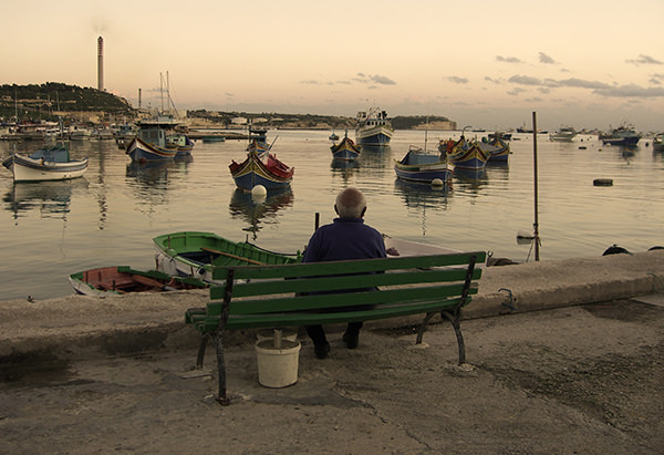 Quiet Times #12 by Jeremy Chin - Old Man on a Bench in Marsaxlokk, Malta