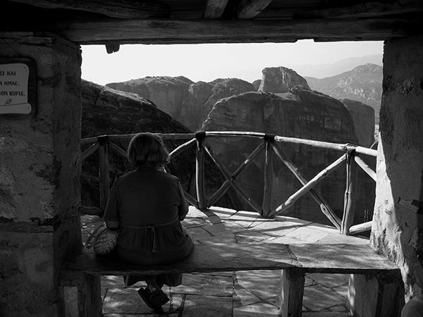Quiet Times #44 by Jeremy Chin - Woman Enjoying the View at Monastery in Meteora, Greece